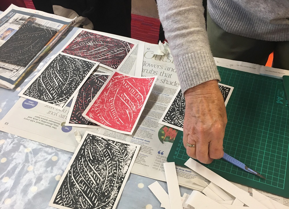 Close up of the Red and black lino prints from the Time To Create workshop.