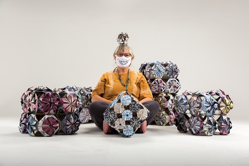 Artist Phiona Richards with origami kusudamas made by Corby over 65s © Paul Stringer